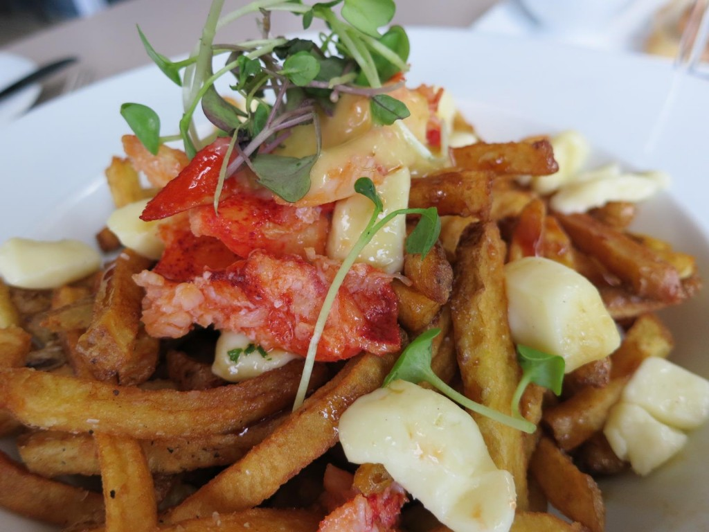 Nova Scotia Lobster PoutineHouse Cut Yukon Fries, Butter Poached Lobster, White Cheddar Cheese Curds, Red Wine Veal Jus, Hollandaise Sauce